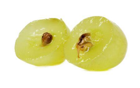 Translucent slice of green grape fruit, macro isolated on white  photo