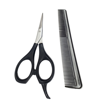Scissors and comb isolated on white background  Stock Photo - 9974065