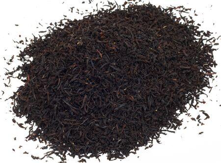 english breakfast tea: Handful of black tea leaves on white background  Stock Photo