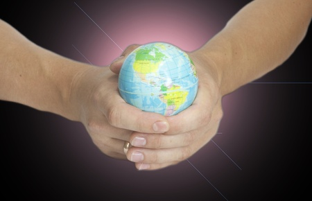 Man holding a glowing earth globe in his hands  Stock Photo - 10918185