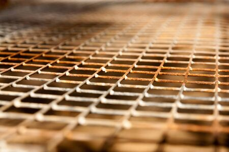 linkage: rusty grid as a background