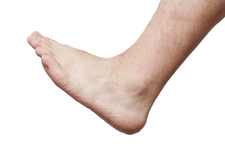 male parts: Mens foot on a white background