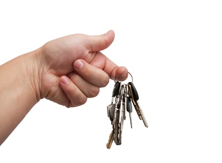Old rusty bunch of keys in hand. Isolated on white Stock Photo - 11285421