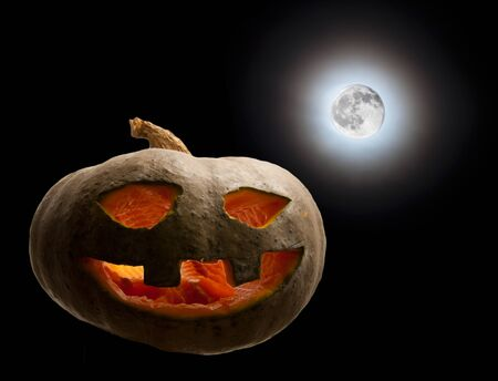 hallowed: pumpkin hallowed moon. Halloween Stock Photo