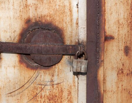 Close up of a rusty vintage padlock  photo