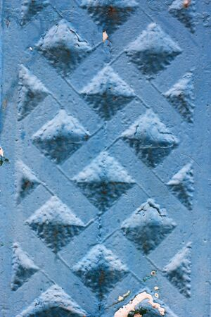 Abstract background of a concrete fence painted in dark blue photo