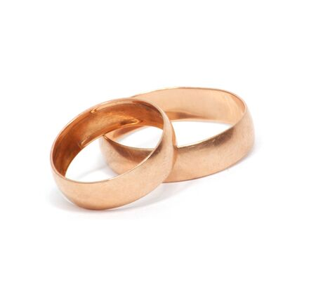 weddingrings: Two gold ring isolated on white  Stock Photo