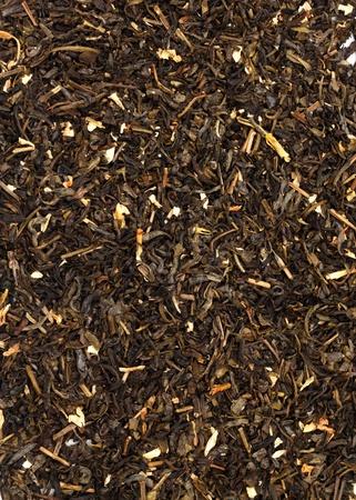 Dry green tea on white background  photo