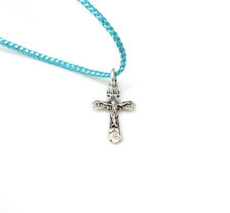coulomb: silver cross on a white background Stock Photo