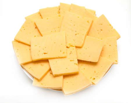 mild: sliced cheese on white background