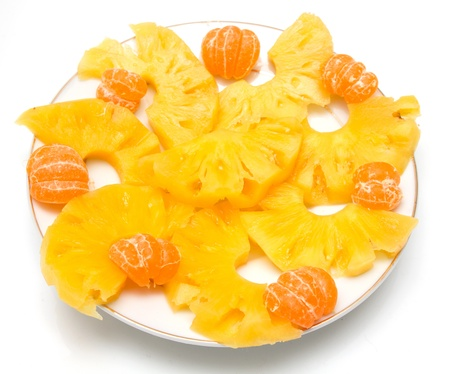 tangerines with pineapple on a white background photo