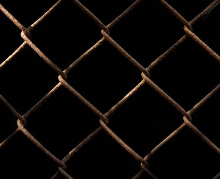 rusty metal grid on a black background Stock Photo