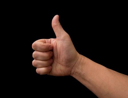 Thumb up hand isolated on black background  photo