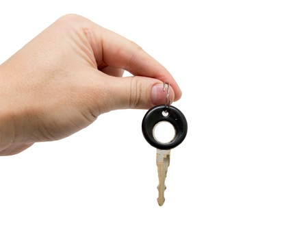 Key in hand on white background photo