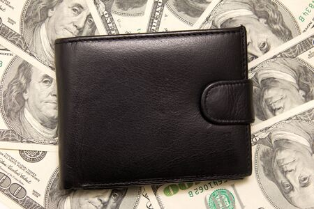 Black purse with money.  photo