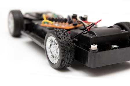disassembled: disassembled toy car on a white background