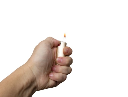 hand with the cigarette lighter on a white background Stock Photo - 13048295