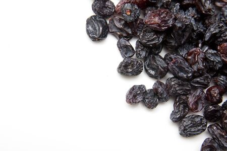 black raisins on a white background Stock Photo - 13049835