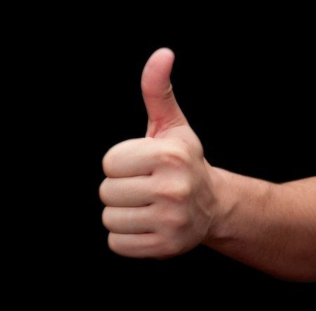 Thumbs up hand isolated on black background  photo