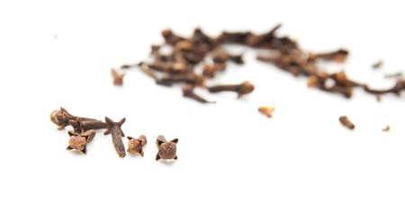 deg: Dried cinnamon on a white background