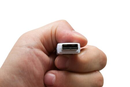 USB flash drive in hand on white background photo