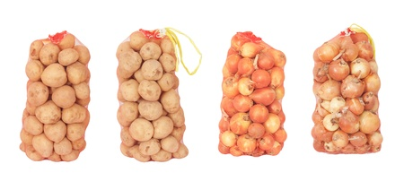 bag of onions and potatoes on a white background photo