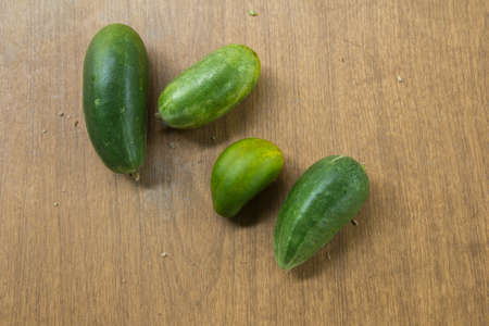 cucumber on a wooden background photo