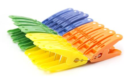 colored clothespins on white background Stock Photo - 14929413
