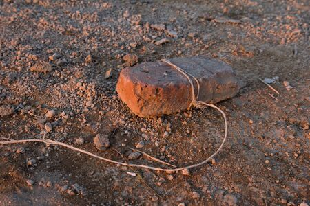sameness: Brick lies on clay Stock Photo