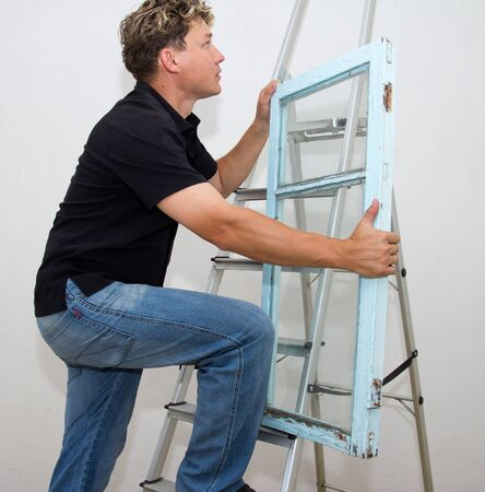 class maintenance: a man with a window on a ladder on a white background