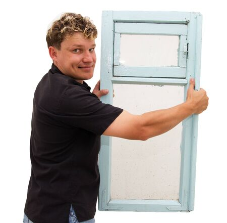 double glazing: man holding an old window on a white background