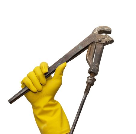 wrench in yellow rubber gloves on white background photo
