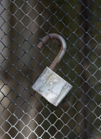 old lock on the fence photo