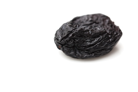 black raisins on a white background photo