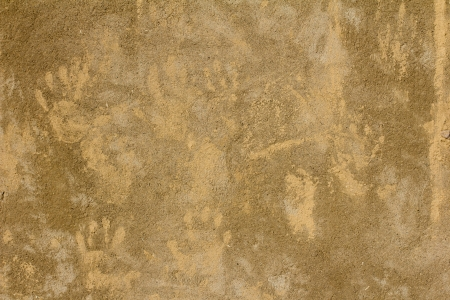 prints of children's hands on a background of concrete photo