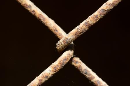 metal grate: connection rusty metal grate. macro