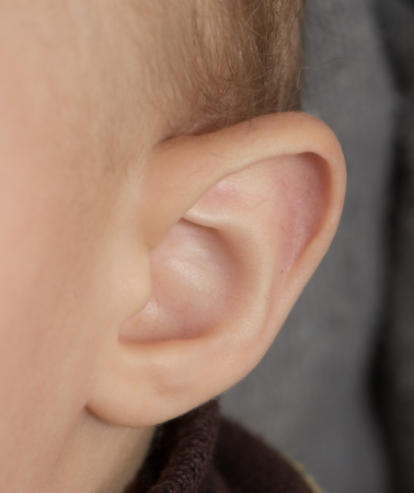 Little human child one listening silence ear macro photo