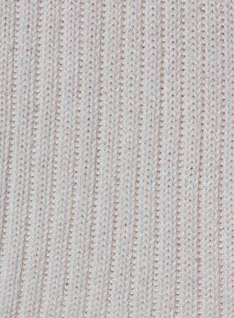 White knitted fabric as background photo