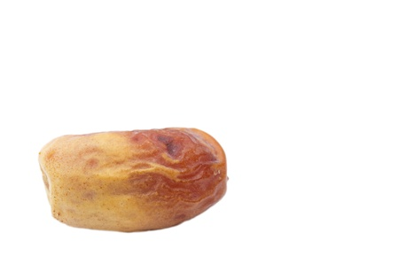 low perspective: Single dried date fruit from low perspective on white background.