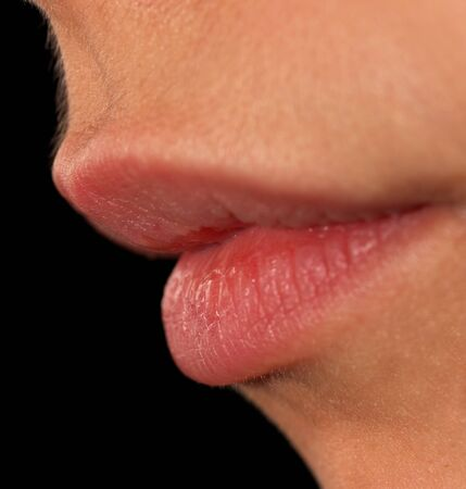 female lips on a black background. macro photo