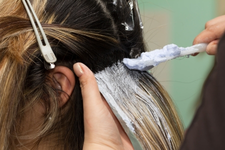 hairdresser parlor: Hair Colouring in process