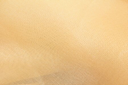 golden fabric as a background. macro photo