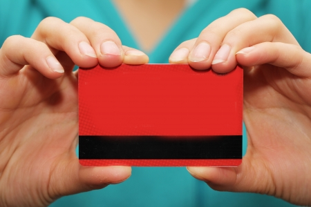 red plastic card in hand photo