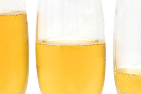 three glasses of champagne on a white background photo