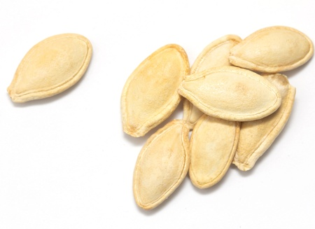 pumpkin seeds on a white background. macro