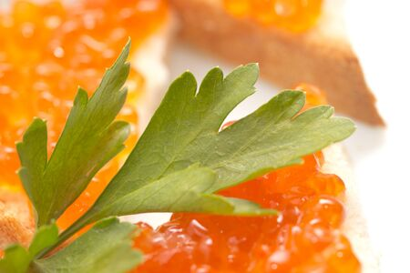 parsley and red caviar photo