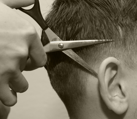 peluquero: tijeras de peluquero o�do Foto de archivo
