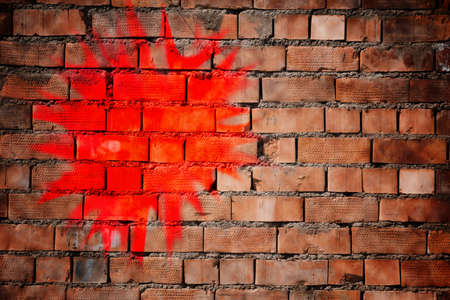 red paint on a brick wall Stock Photo - 18241069
