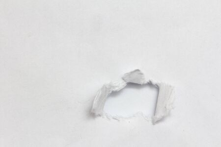 Hole ripped non color paper. White background photo