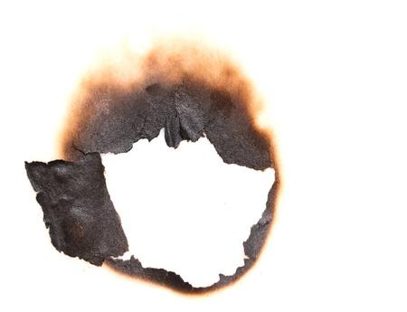 ホワイト ペーパーの背景に燃やされた穴 写真素材